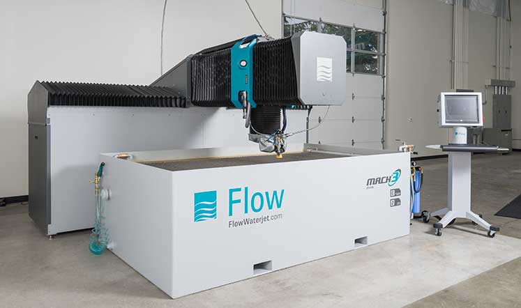 Flow Mach 3bc waterjet, showcases a rugged mechanical design.