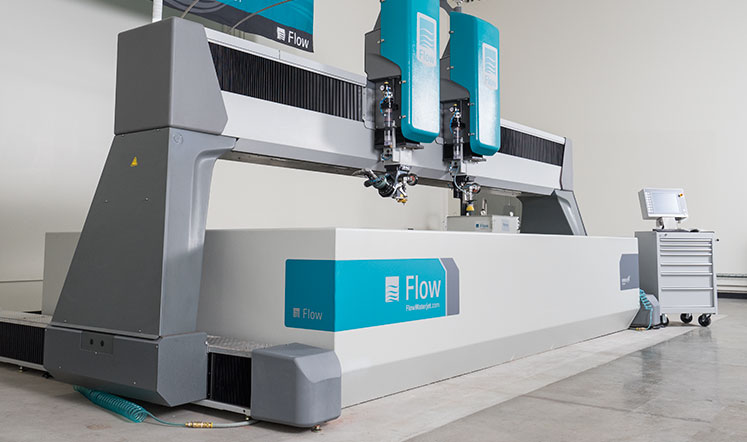 Side view of Flow's Mach 4c waterjet. With a durable design, they are engineered tough.
