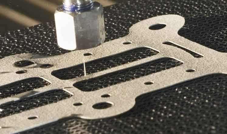 Close up of pure waterjet cutting gasket. Demonstrating versatility and ability to switch to either abrasive or pure water cutting.