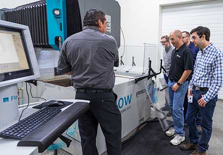 Training on the Mach 3 waterjet at the Customer Technology Center.