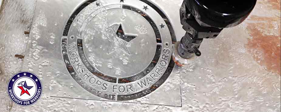 Flow Waterjet cutting Workshops for Warriors logo on metal sheet